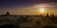 Hot air balloons over Buddhist temples, Bagan, Myanmar