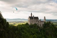 Paragliding over Neuschwanstein castle, Fussen, Bavaria, Germany