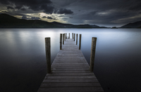 Pier on lake at sunset, England, UK