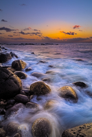 Rocky sea coast at dusk