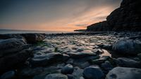 Dusk over rocky beach