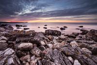 Volcanic rock coast at sunset, Baskemolla, Skane County, Sweden