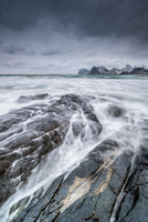Rocky coastline of Norwegian Sea in moody weather, Myrland, Lofoten, Norway