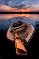 Boat on lakeside at sunset, Espoo, Finland