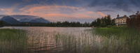 Lake with building and mountains in background, Tatra mountains, Strbske Pleso, Slovakia