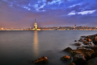Illuminated Maidens Tower on coast in evening, Istanbul, Turkey