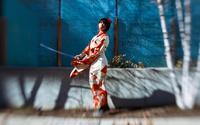 Woman in traditional Japanese kimono holding katana, Toronto, Ontario, Canada