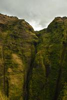 Waterfall on cliff, Poipu, Hawaii, USA