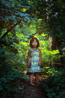 Portrait of girl (2-3) standing in forest, Brooklyn, New York City, New York State, USA