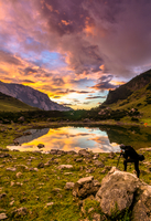 Man photographing mountain landscape during sunrise