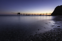 Sunset over Adriatic Sea beach with pier, Vasto, Abruzzo, Italy