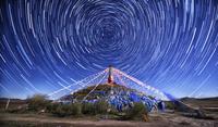 Star trails over Tibetan Buddhist stupa, Inner Mongolia, China
