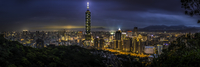 Illuminated city at dusk, Taipei, China