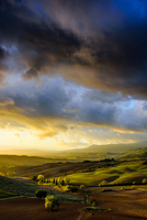 Rural landscape with dramatic sky, Tuscany, Italy