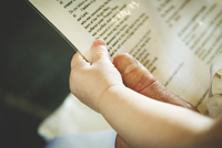 Man and baby (12-23 months) holding baptism ceremony text