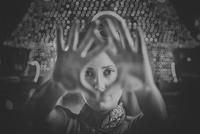 Woman making finger frame
