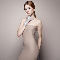 Fashion portrait of elegant woman in dress