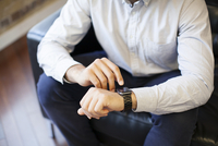 Businessman using smart watch