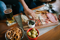 Indulging in a charcuterie at a house party