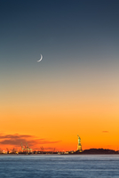 Statue of Liberty under a new moon