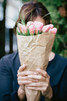 a close up of a person holding a flower
