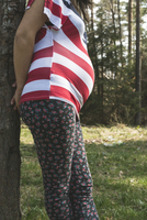 Pregnant woman in the forest