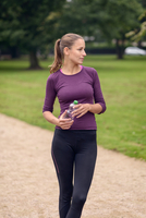 Athletic Woman Drinking Water After an Exercise