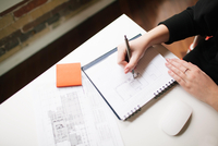 Businesswoman writing in notebook. 11098082991| 写真素材・ストックフォト・画像・イラスト素材|アマナイメージズ