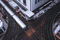 a train is parked on the side of a building 11098083036| 写真素材・ストックフォト・画像・イラスト素材|アマナイメージズ