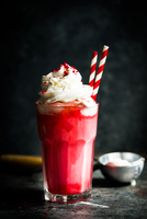 Cherry milkshake on rustic background