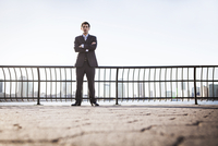 Portrait of young businessman with arms crossed