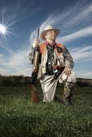 Hunter kneeling on grass