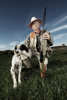Hunter with dog in field