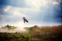 Motocross rider performing stuns