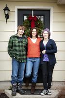 Family with two children (16-17, 14-15) in front of door