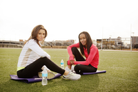 Two women resting after work out
