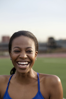 Portrait of Woman Laughing On Field