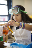 Girl doing scientific experiments at school