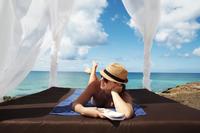 Woman lying on towel