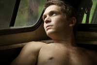 Man looking out car window
