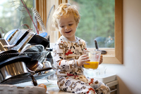 Portrait of toddler (2-3) holding measuring cup with eggs
