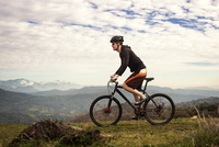 Man riding cross country on mountain bike