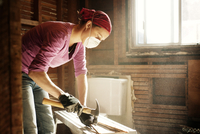 Woman doing home construction