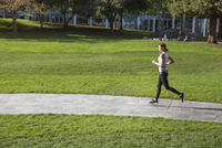 Woman running in park on sunny day