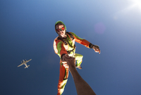 Skydiver holding someone's hand in air