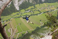 Man base-jumping into valley