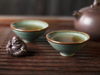 Still life with japanese tea pot and cups and small statue of Buddha