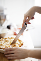 Young woman slicing pie