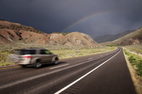 Driving on stormy mountain road