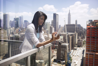 Woman on balcony using smartphone